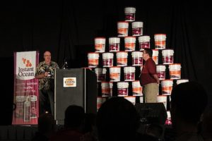Dana Riddle, left, on stage at MACNA 2011 with Steven Pro, right.