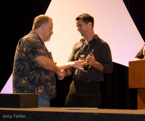 Dr. Matt Wittenrich, right, being handed the award by MASNA President, Steve Allen, left.